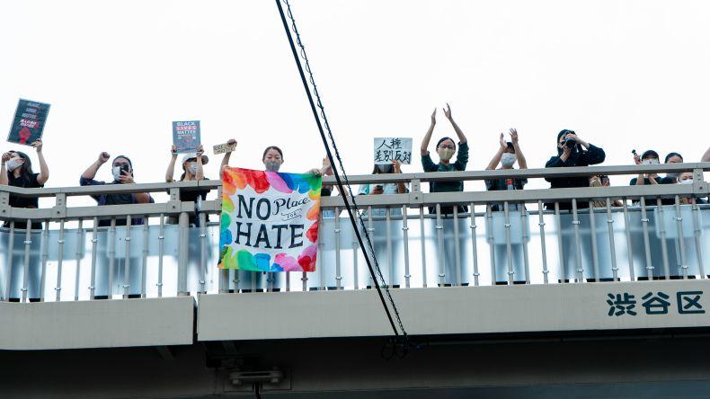 protestors on a bridge in Tokyo