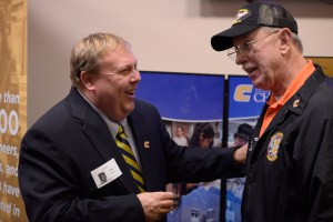 UT Chattanooga's Chuck Cantrell talks with a veteran at UT Day on the Hill.