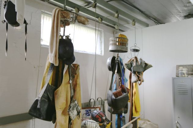 Miners changed before work and place their clothes on hooks to hoist out of the way.