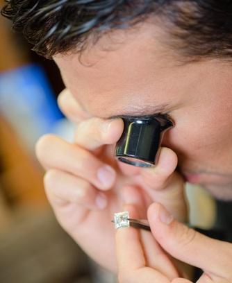 An expert examining a diamond
