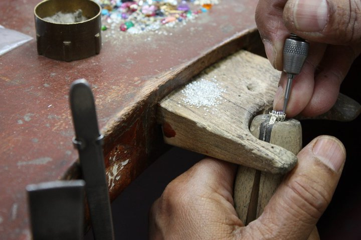 The Diamond Store jewellery preparing a ring for stone setting in his London workshop