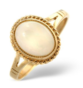 Opal cabochon ring in yellow gold with rubover setting