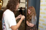 Harry Styles and Rays of Sunshine One Direction Wish - harry Styles giving fan a heart necklace