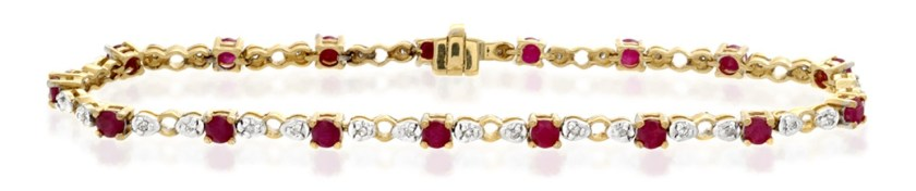 Ruby bracelet with diamond accents in yellow gold