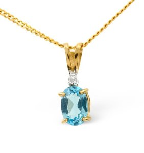Blue sapphire pendant necklace in yellow gold