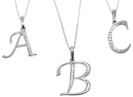 Best Christmas Jewellery Gifts - Initial letter pendant necklaces with diamonds and gold - click to view details