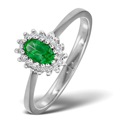 Emerald ring with diamonds in white gold