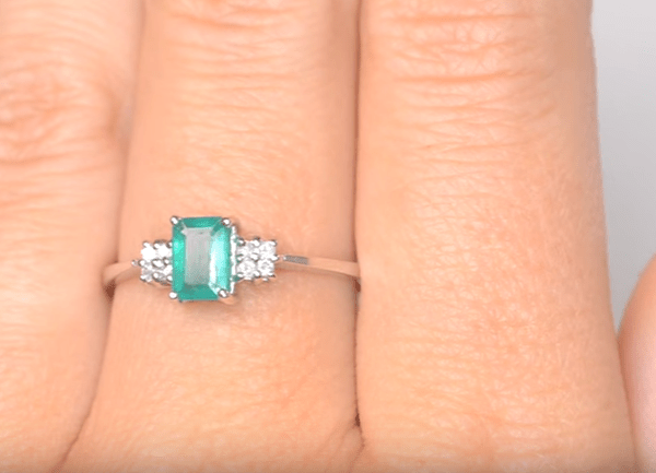 These are the 10 best emerald rings in the UK - Dainty emerald ring with rectangular cut with accent diamonds
