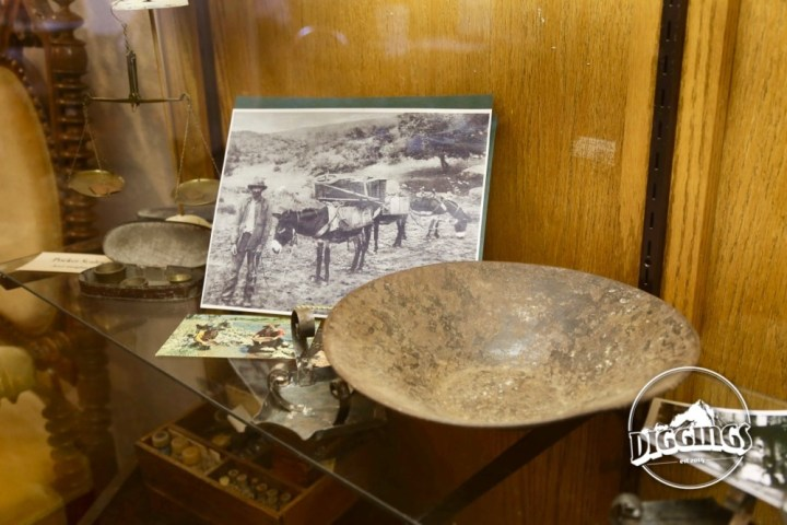 Prospectors, pans, and gold scales on display at the Gold Nugget Museum