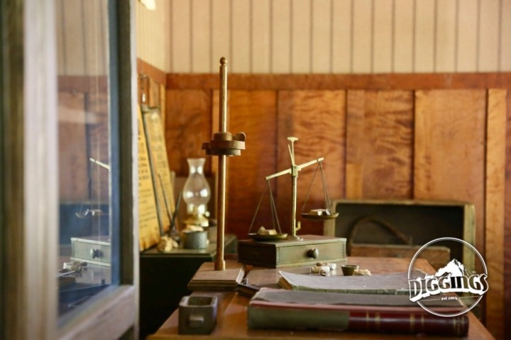 Scale, books, and other assaying equipment at the Gold Nugget Museum