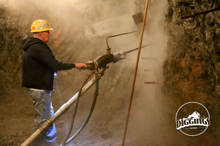 A tour guide demonstrates trilling technique in the Sierra Silver Mine