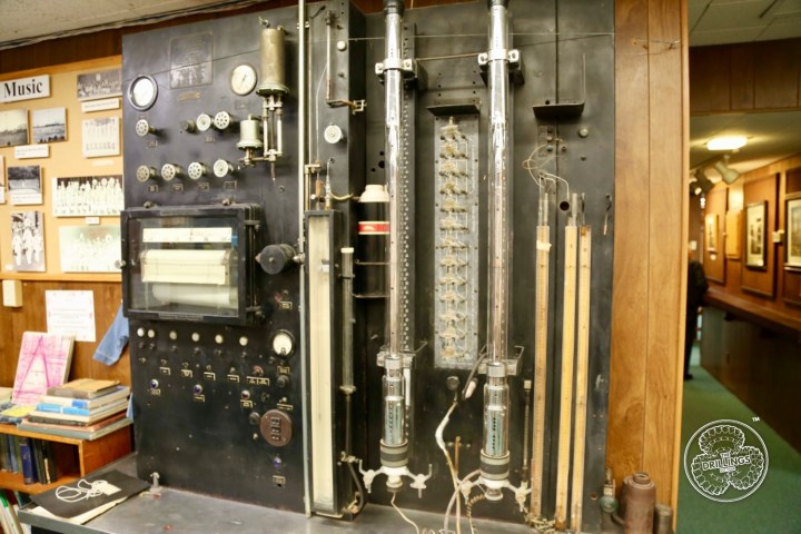 This Hyd-robot (hydraulically operated automatic low-temperature fractional distillation apparatus) was brought used in 1942 from the Watson refinery. (We are searching to find out how old it really is.)  The computer is purely mechanical. Both oil and gas were run, and it is said it took a whole day to get four components. Liquid nitrogen was kept in the thermos.