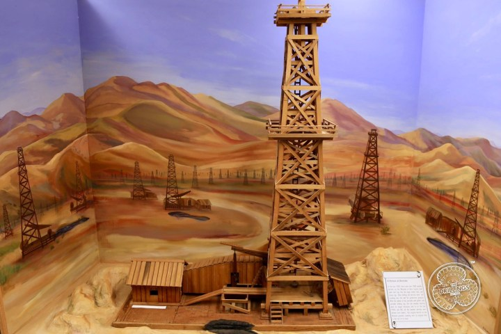In the late 1920's there were over 7000 wooden derricks on the Westside of Kern County, both cable tool rigs, like the large model here, and rotary rigs. After drilling, the derricks were left standing over the well for production purposes. With the advent of the portable well pullers, and portable drilling rigs, the old wooden derricks were no longer necessary, and so in the late 1950s and 60's all the wooden derricks were thrown (town down). Our original derrick on the Museum grounds, standing over its original hole, is the last of its kind.