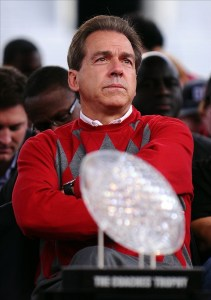 Jan. 21, 2012; Tuscaloosa, AL, USA;  Alabama Crimson Tide coach Nick Saban looks out at the crowd behind  the Coaches' Trophy during the Alabama Football National Championship Celebration at Bryant-Denny Stadium. Photo Credit: Kelly Lambert-US PRESSWIRE