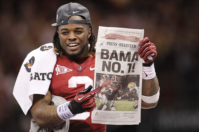 Jan 9, 2012; New Orleans, LA, USA; Alabama Crimson Tide running back Trent Richardson (3) holds the newspaper with a photo of himself after defeating the LSU Tigers 21-0 in the 2012 BCS National Championship game at the Mercedes-Benz Superdome. Photo Credit: Derick E. Hingle-US PRESSWIRE