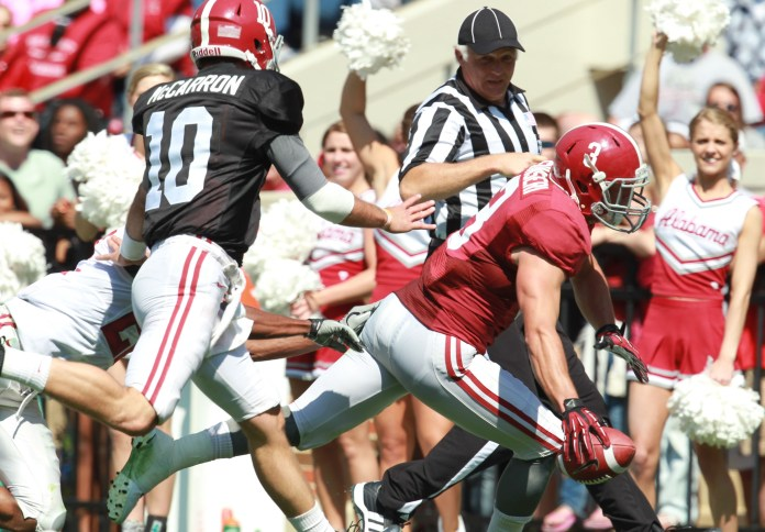 Apr 20, 2013; Tuscaloosa, AL, USA; Alabama Crimson Tide Red Team defensive back Vinnie Sunseri (3) scores a touchdown on an interception by a pass thrown by White Team quarterback AJ McCarron (10) during the annual A-Day game at Bryant Denny Stadium. Mandatory Credit: Marvin Gentry-USA TODAY Sports