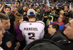 Texas A&M Aggies quarterback Johnny Manziel (2) talks to the media after the game against the Oklahoma Sooners during the Cotton Bowl at Cowboys Stadium. Texas A&M beat Oklahoma 41-13. Mandatory Credit: Tim Heitman-USA TODAY Sports
