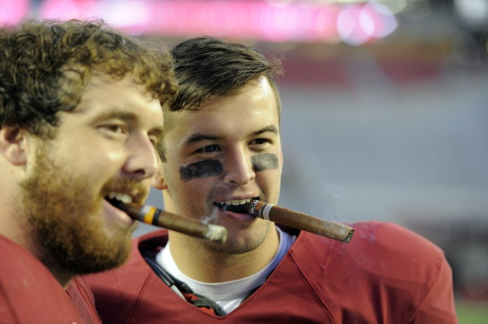 Oct 26, 2013; Tuscaloosa, AL, USA; Alabama Crimson Tide quarterback A.J. McCarron (10) smoke a cigar with offensive linesman Anthony Steen (61) following their 45-10 victory over the Tennessee Volunteers at Bryant-Denny Stadium. Mandatory Credit: John David Mercer-USA TODAY Sports