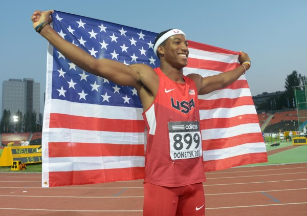 Donetsk, UKRAINE; Marlon Humphrey (USA) poses with a United States flag after finishing second in the 110m hurdles in the 2013 IAAF World Youth Championships at Olimpiyskiy Stadium. Mandatory Credit: Kirby Lee-USA TODAY Sports