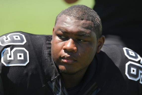 Jul 3, 2013; Beaverton, OR, USA; Defensive lineman Josh Frazier (99) looks on during the Lineman Challenge session of the 'The Opening' at Nike World Headquarters. Mandatory Credit: Steve Dykes-USA TODAY Sports
