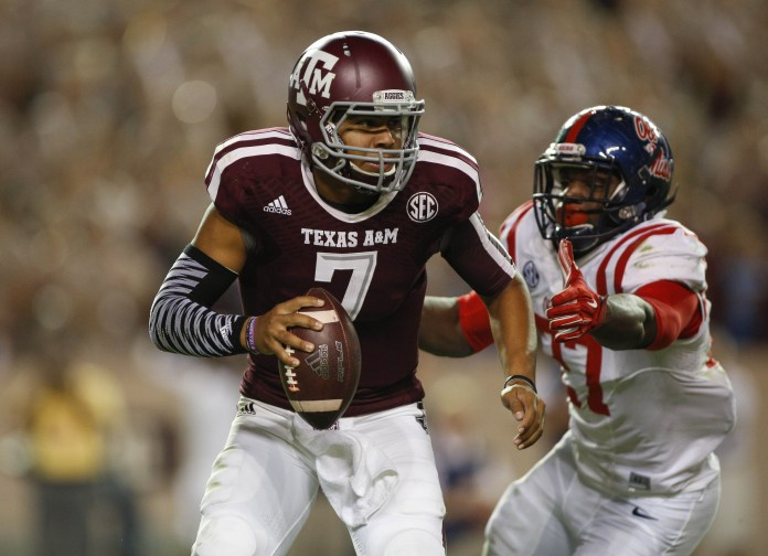Oct 11, 2014; College Station, TX, USA; Texas A&M Aggies quarterback Kenny Hill (7) scrambles during the fourth quarter as Mississippi Rebels defensive end Marquis Haynes (27) applies pressure at Kyle Field. The Rebels defeated the Aggies 35-20. Mandatory Credit: Troy Taormina-USA TODAY Sports