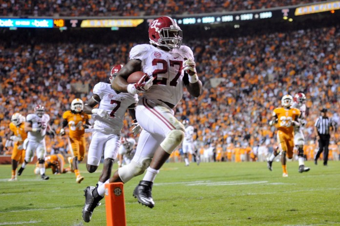 Oct 25, 2014; Knoxville, TN, USA; Alabama Crimson Tide running back Derrick Henry (27) scores a touchdown against the Tennessee Volunteers during the second half at Neyland Stadium. Mandatory Credit: Randy Sartin-USA TODAY Sports