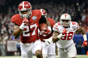 Jan 1, 2015; New Orleans, LA, USA; Alabama Crimson Tide running back Derrick Henry (27) runs past Ohio State Buckeyes defensive lineman Steve Miller (88) during the first quarter of the 2015 Sugar Bowl at Mercedes-Benz Superdome. Mandatory Credit: Derick E. Hingle-USA TODAY Sports