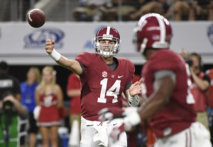 Sep 5, 2015; Arlington, TX, USA; Alabama Crimson Tide quarterback Jake Coker (14) passes against the Wisconsin Badgers during the second quarter at AT&T Stadium. Mandatory Credit: Richard Mackson-USA TODAY Sports