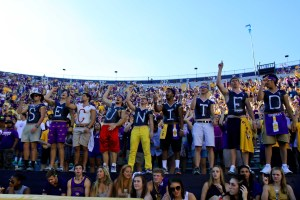 Oct 10, 2015; Baton Rouge, LA, USA; LSU Tigers fans in the student section are painted to spell SEC united in support of the South Carolina Gamecocks who hosted a home game at Tiger Stadium due to flooding in South Carolina. LSU defeated South Carolina 45-24. Mandatory Credit: Derick E. Hingle-USA TODAY Sports