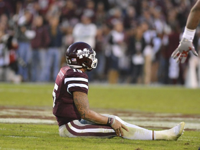 Nov 14, 2015; Starkville, MS, USA; Mississippi State Bulldogs quarterback Dak Prescott (15) reacts after a play in the third quarter of the game against the Alabama Crimson Tide at Davis Wade Stadium. Alabama won 31-6. Mandatory Credit: Matt Bush-USA TODAY Sports