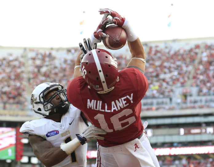 Nov 21, 2015; Tuscaloosa, AL, USA; Alabama Crimson Tide wide receiver Richard Mullaney (16) catches a pass over Charleston Southern Buccaneers cornerback Raymere Thomas (1) for a touchdown at Bryant-Denny Stadium. Mandatory Credit: Marvin Gentry-USA TODAY Sports
