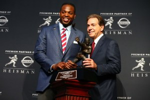 Dec 12, 2015; New York, NY, USA; Alabama running back Derrick Henry (left) and head coach Nick Saban pose with the Heisman Trophy during a press conference at the New York Marriott Marquis after the 81st annual Heisman Trophy presentation. Mandatory Credit: Brad Penner-USA TODAY Sports