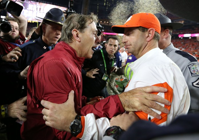 Jan 11, 2016; Glendale, AZ, USA; Clemson Tigers head coach Dabo Swinney congratulates Alabama Crimson Tide head coach Nick Saban following the 45-40 victory in the 2016 CFP National Championship at University of Phoenix Stadium. Mandatory Credit: Matthew Emmons-USA TODAY Sports