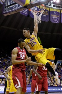 Jan 16, 2016; Baton Rouge, LA, USA; LSU Tigers forward Ben Simmons (25) hangs on the rim after a dunk over Arkansas Razorbacks forward Keaton Miles (55) during the second half of a game at the Pete Maravich Assembly Center. LSU defeated Arkansas 76-74. Mandatory Credit: Derick E. Hingle-USA TODAY Sports