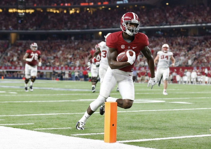 Sep 5, 2015; Arlington, TX, USA; Alabama Crimson Tide receiver Robert Foster (8) runs for a touchdown in the second quarter after a reception against the Wisconsin Badgers at AT&T Stadium. Mandatory Credit: Matthew Emmons-USA TODAY Sports