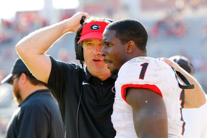 Apr 16, 2016; Athens, GA, USA; Georgia Bulldogs head coach Kirby Smart talks to running back Sony Michel (1) during the second half of the spring game at Sanford Stadium. The Black team defeated the Red team 34-14. Mandatory Credit: Brett Davis-USA TODAY Sports