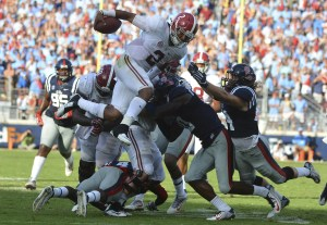 Sep 17, 2016; Oxford, MS, USA; Alabama Crimson Tide quarterback Jalen Hurts (2) leaps to avoid a tackle during the third quarter of the game against the Mississippi Rebels at Vaught-Hemingway Stadium. Alabama won 48-43. Mandatory Credit: Matt Bush-USA TODAY Sports
