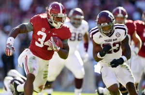Oct 22, 2016; Tuscaloosa, AL, USA; Alabama Crimson Tide running back Damien Harris (34) carries the ball against the Texas A&M Aggies during the second quarter at Bryant-Denny Stadium. Mandatory Credit: John David Mercer-USA TODAY Sports