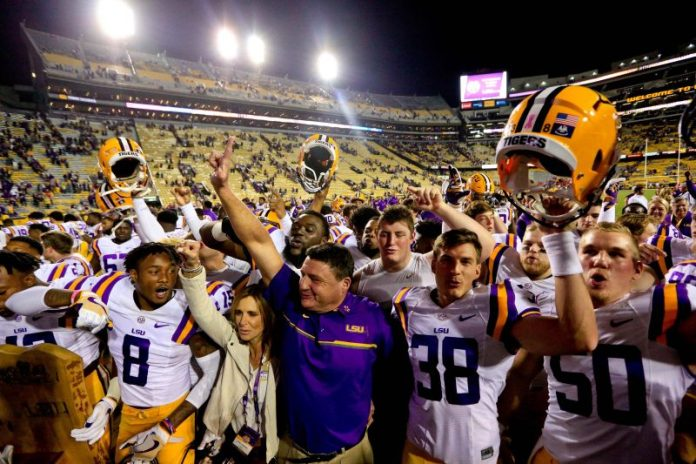 Oct 22, 2016; Baton Rouge, LA, USA; LSU Tigers head coach Ed Orgeron celebrates with his team following a win against the Mississippi Rebels in a game at Tiger Stadium. LSU defeated Mississippi 38-21. Mandatory Credit: Derick E. Hingle-USA TODAY Sports