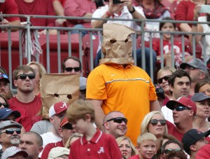 Oct 21, 2017; Tuscaloosa, AL, USA; Tennessee Volunteers fans shield their faces during the game against Alabama Crimson Tide during the second quarter at Bryant-Denny Stadium. Mandatory Credit: Marvin Gentry-USA TODAY Sports
