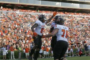Sep 16, 2017; Auburn, AL, USA; Mercer Bears receiver Marquise Irvin (8) celebrates with linemen Jake Flath (76) and Caleb Yates (65) after scoring a touchdown against the Auburn Tigers during the fourth quarter at Jordan-Hare Stadium. Mandatory Credit: John Reed-USA TODAY Sports