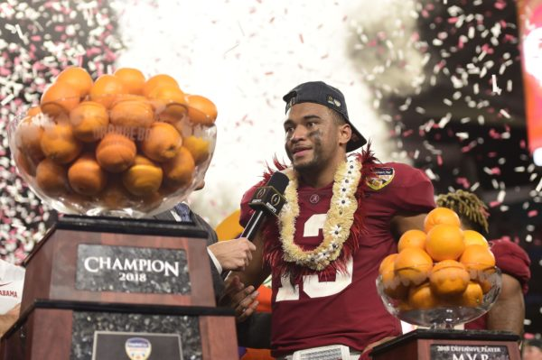 Dec 29, 2018; Miami Gardens, FL, USA; Alabama Crimson Tide quarterback Tua Tagovailoa (13) reacts after winning MVP after defeating the Oklahoma Sooners during the 2018 Orange Bowl college football playoff semifinal game at Hard Rock Stadium. Mandatory Credit: Tommy Gilligan-USA TODAY Sports