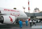 Ground crew stand by an Air Arabia Airbu
