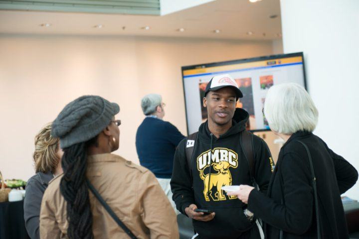 Guests in UMBC's Black and Gold alumni lounge at Light City 2017.