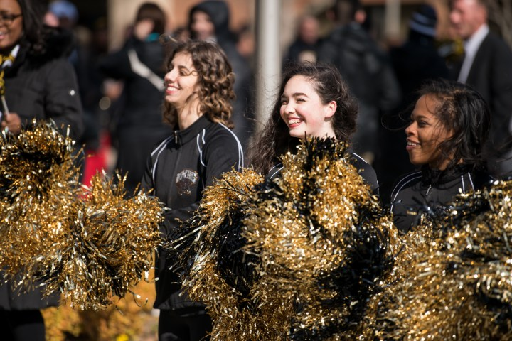 Cheerleaders in black and gold.