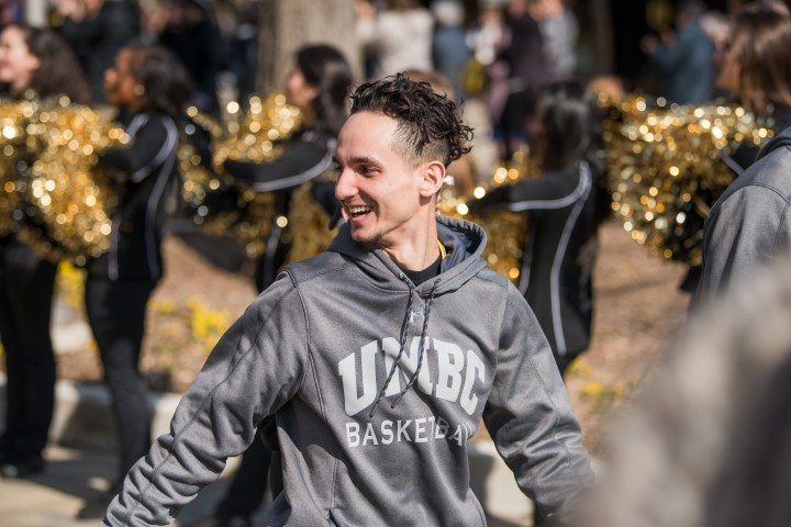 Basketball player smiles in crowd.