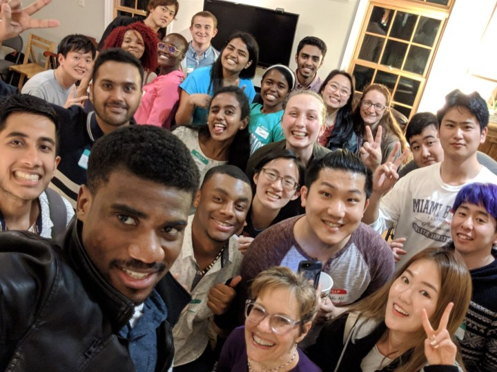 A large group of students poses for a selfie.