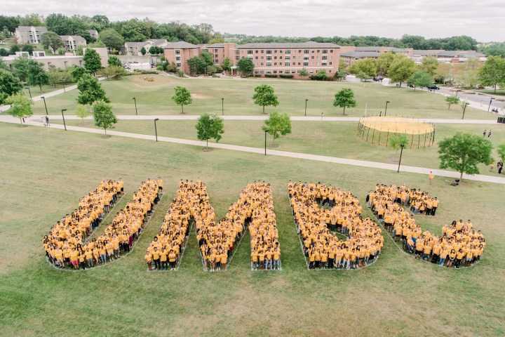 """New students spell out """"UMBC"""" during Welcome Week, fall 2019."""