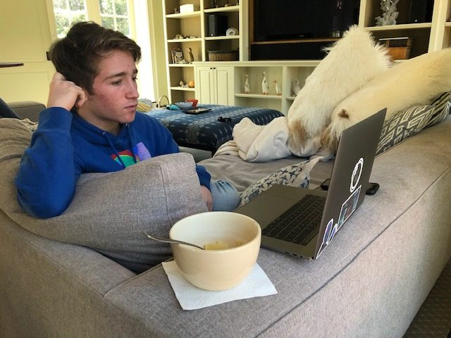 Cooper Roth working remotely at his family home.
