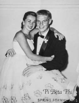Education driven Tom Capehart photographed with his wife, Karen, at their spring formal dance. She is sitting on his lap with her arms wrapped around him.